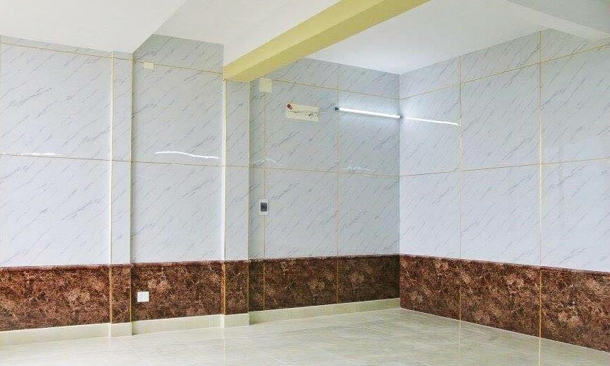 Phòng ngủ với tường lát tấm